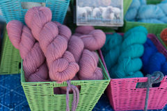 Colorful wool in rectangular baskets Stock Photo