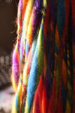 Colorful wool strings for hand spinning on an outdoor craft mark Royalty Free Stock Photography