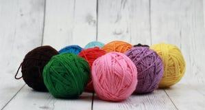Colorful wool yarn balls. Concept and Decorative wool yarn balls stock photos