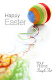 Colorful wool yarns unwraped from easter egg Royalty Free Stock Images