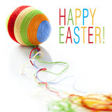 Colorful wool yarns unwraped from easter egg Stock Photography