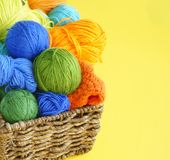 Colorful woolen balls of yarn. Balls of yarn are in the basket. Needlework. royalty free stock images