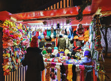 Colorful woolen clothes and consumer at Riga Street Christmas Market. Warm colorful mittens, gloves, socks and hats at one of the stalls at the street Christmas Royalty Free Stock Photo