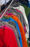 Woolen clothes. Colorful woolen clothes hanging in the shop royalty free stock photo