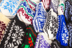 Colorful woolen mittens on the market counter Royalty Free Stock Image