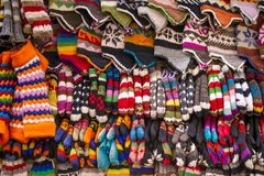 Colorful woolen socks, hats and gloves Stock Photo