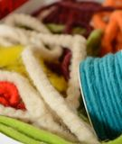Colorful woolen threads - felt ribbons stock photography