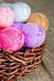 Colorful woolen yarn on rustic wooden background Royalty Free Stock Photo