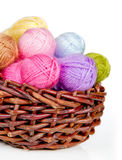 Colorful woolen yarn in a wicker basket Stock Photos