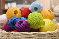 Colorful wools. Colorful wool's balls in a basket Royalty Free Stock Photos
