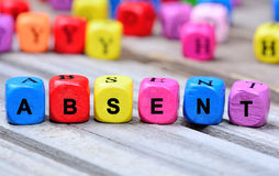 The colorful word Absent on table Royalty Free Stock Photos