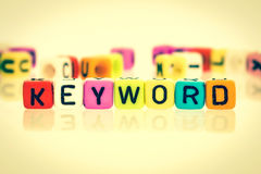 Colorful word cube of  keyword Royalty Free Stock Photos