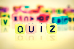 Colorful word cube of  QUIZ. Retro color tone Royalty Free Stock Photos