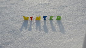 Colorful word winter on winter snow stock video