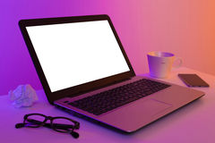 Colorful workplace - laptop computer with blank screen royalty free stock image