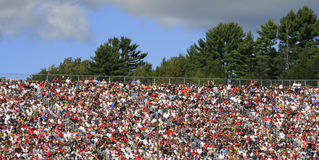 The colorful world of NASCAR 2. Fans pack the stands at New Hampshire International Raceway Stock Photos