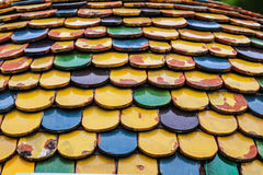 Colorful worn out round tiles with yellow green and blue colors Stock Photos