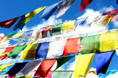 Colorful worship flag in Nepal. Colorful worship flag with the blue sky background in Nepal royalty free stock images