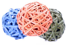 Colorful woven balls. A trip of colorful woven balls on white Stock Photography