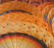 Colorful woven baskets from the branches. Stock Photography
