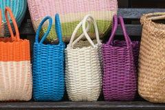 Colorful woven handbags Stock Photos