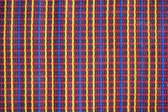 Colorful woven mat with natural patterns. Royalty Free Stock Image
