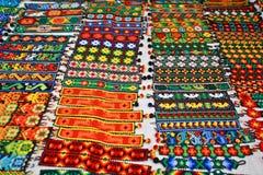 Colorful woven mexican friendship bracelets. Colorful handcrafted bracelets on mexican market Stock Photos
