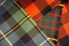 Colorful woven wool tartan plaid cloth fabric. Pattern of choice for clan members in Scotland and elsewhere Stock Image