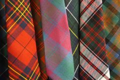 Colorful woven wool tartan plaid cloth neckties. Worn by clan members in Scotland and elsewhere Royalty Free Stock Photos