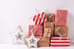 Colorful wrapped gift boxes with presents and decorative  stars Royalty Free Stock Photo