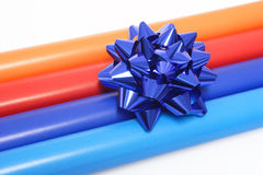 Colorful wrapping paper and a gift bow Stock Images