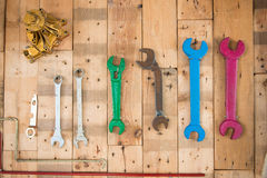 Colorful wrench hang on wood wall Stock Photography