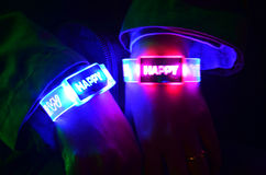 Colorful wrist band lighting with Happy New year word Stock Photos