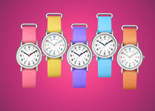 Colorful wrist watches on fuchsia background. Composition with colorful wrist watches on fuchsia background Royalty Free Stock Photo