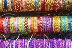 Colorful wristbands. Fabric textured background. Hand made Royalty Free Stock Photography