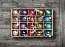 Colorful Xmas balls on old grey wood background Royalty Free Stock Image