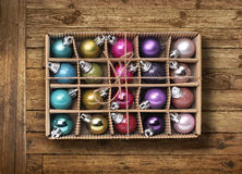 Colorful Xmas balls on old wood background Royalty Free Stock Photography