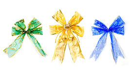 Colorful xmas bows. Three beautiful colorful christmas bows isolated on white background Royalty Free Stock Photography