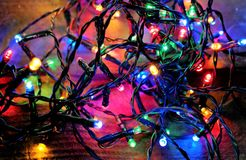 Christmas festive lights and new years eve colorful background. Colorful xmas garland or new years eve conceptn Stock Photos