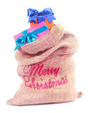 Colorful Xmas gifts in Santas sack Royalty Free Stock Photos