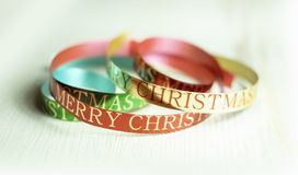 Free Colorful Xmas Ribbon With Merry Christmas Greeting Royalty Free Stock Photography - 131848867