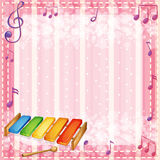 A colorful xylophone with musical notes Royalty Free Stock Photography