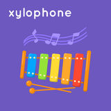 Colorful xylophone and notes. Royalty Free Stock Photography