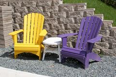 Colorful Yard Chairs. On a sunny day stock photo
