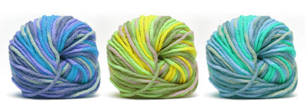 Colorful yarn. Tree bales of colorful yarn isolated over white Royalty Free Stock Photo