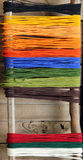 Colorful yarn on a background of wooden wall Stock Photos