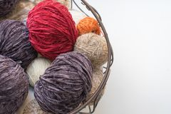 Knitting yarn balls in a basket stock images