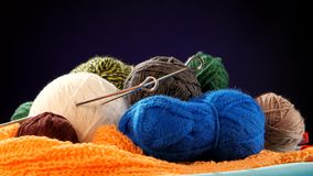 Colorful yarn balls with spokes on orange scarf stock video footage