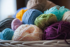 Colorful yarn balls in wicker basket  on white Stock Photos