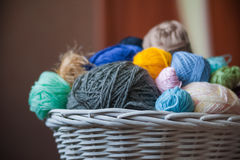 Colorful yarn balls in wicker basket  on white Royalty Free Stock Photography
